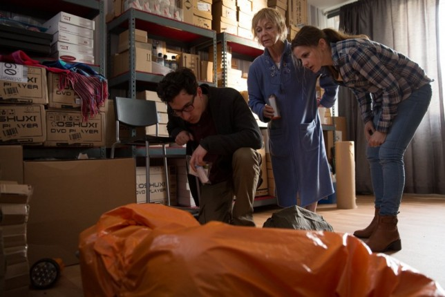 containment-2015-001-trio-in-warehouse-studying-body-bag-ORIGINAL